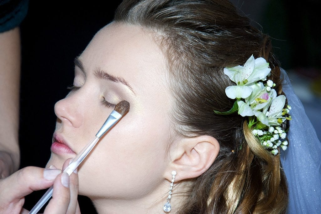 Bride getting make up on
